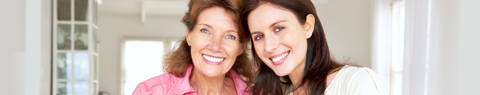 Adult mother and daughter smiling